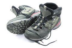 Pair of dirty grey hiking boots  on white background Stock Photo