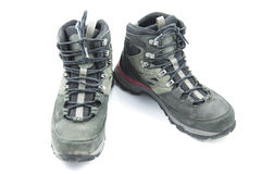 Pair of dirty grey hiking boots  on white background Royalty Free Stock Photography