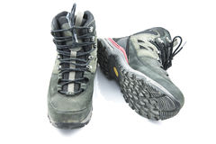 Pair of dirty grey hiking boots  on white background Stock Photos