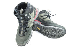 Pair of dirty grey hiking boots  on white background Royalty Free Stock Photos
