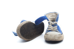 Pair of dirty, worn out blue children sneakers Royalty Free Stock Photography