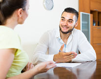 Pair discussing terms of contract at home Royalty Free Stock Photos