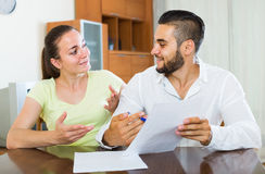 Pair discussing terms of contract at home Stock Image