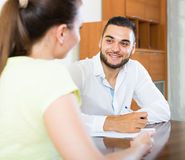 Pair discussing terms of contract at home Stock Photos