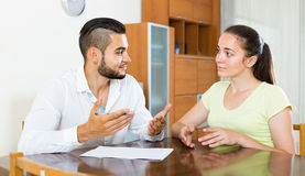 Pair discussing terms of contract at home Stock Images