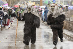 Pair of dreadful wild mask at Carnival parade, Stuttgart Stock Photo