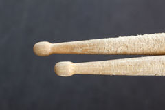 Pair of drumsticks against dark blue background Stock Image