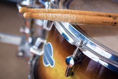 Pair of drumsticks lying on tom-tom drum. Stock Photography
