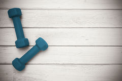 Pair of dumbbells on wooden background Royalty Free Stock Photos