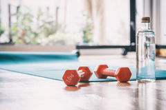 Pair of dumbbells on a wooden floor Royalty Free Stock Photography