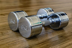 Pair of Dumbells in a Sport Fitness Room Royalty Free Stock Photo
