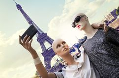Pair of dummies tourists take a selfie. Against silhouette of tour eiffel in paris. concept people travelin stock image