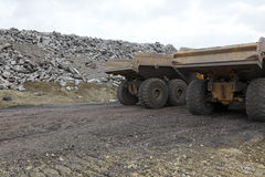 Pair of dump trucks in gravel Stock Image