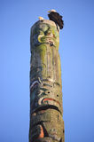 Pair of Eagles and Totem Pole Stock Photography