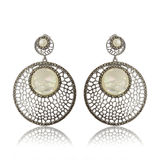 Pair of earrings isolated on the white background Stock Photos