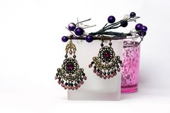 Pair of earrings  on white background. A Pair of Ethnic style earrings placed on a display stand very neatly Royalty Free Stock Images