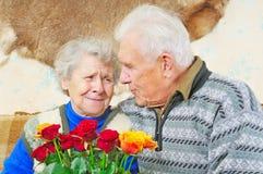 Pair elderly people. Elderly man sit near elderly woman Stock Photography