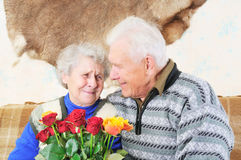 Pair elderly people. Elderly man sit near elderly woman Royalty Free Stock Images