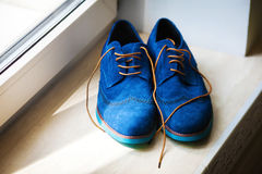 Pair of elegant grooms blue shoes Stock Photography