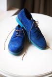 Pair of elegant grooms blue shoes Stock Image