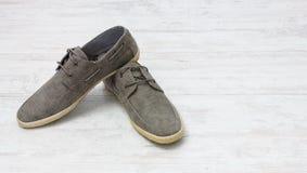Pair of elegant light shoes on wooden white floor Royalty Free Stock Image