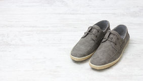 Pair of elegant light shoes on wooden white floor Royalty Free Stock Photography