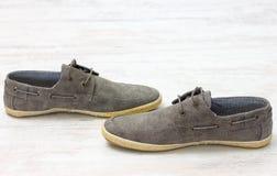 Pair of elegant light shoes on wooden white floor Stock Image