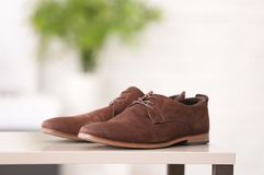 Pair of elegant male shoes. Against blurred background Stock Photography
