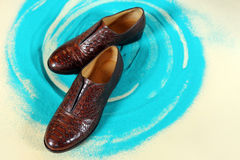 A pair of elegant men`s shoes. A pair of brown elegant men`s shoes Royalty Free Stock Images