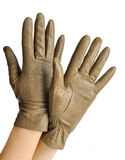 A pair of elegant womens leather gloves. Dressed in his hands Royalty Free Stock Images