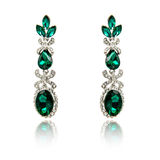 Pair of emerald earrings isolated Stock Images