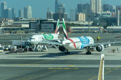 A pair of Emirates Airlines Airplanes with Expo 2020 logos. They park at the Dubai International Airport royalty free stock images