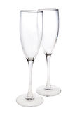 Pair of empty champagne glasses. Isolated on white Royalty Free Stock Photo