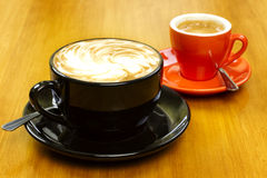 Pair of espresso drinks on wood table Royalty Free Stock Photos