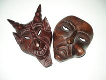 Pair evil satanic Weird wooden evil mask royalty free stock photography