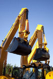 Pair Of Excavators Arms Next to Each Other Royalty Free Stock Photos
