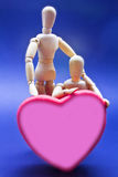 Pair of expressing his love dolls Stock Images