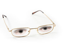 Pair of eyeglasses with eyes, white background Stock Image