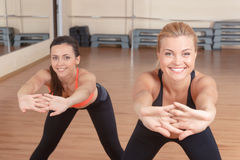 Pair f women stretching forward Stock Image