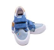 Pair of fashion denim baby shoes for the toddlers feet. Kids sneakers isolated on white background. Royalty Free Stock Photos