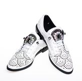 Pair of fashionable comfortable oxfords shoes. Female footwear concept. Footwear for women on flat sole with perforation. And rhinestones. Shoes made out of Stock Photography