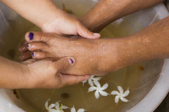 A pair of feet in a bowl full of water Royalty Free Stock Photo