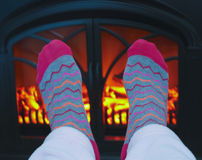 A Pair of Feet and a Cozy Fire Royalty Free Stock Image