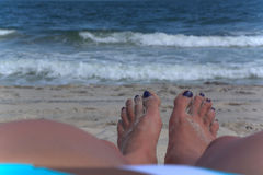 A Pair of Feet Facing the Ocean Stock Images