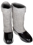 Pair of felt boots in black rubber galosh Royalty Free Stock Photo