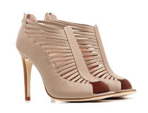 Pair of female beige shoes Stock Images