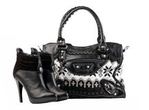 Pair of female boots and handbag over white Royalty Free Stock Photography