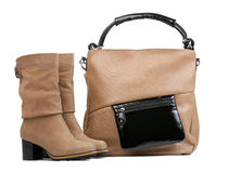 Pair of female boots and handbag over white Stock Image