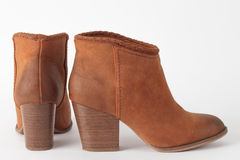 A pair of boots. A pair of female brown leather ankle boots royalty free stock images