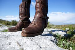Pair of female brown leather boots Royalty Free Stock Images
